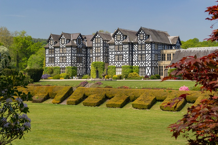 Gregynog Hall viewed with the lawns in the foreground